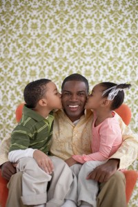 Children Kissing Their Father on His Cheeks