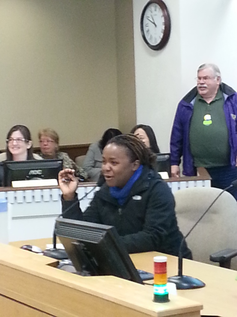 Makini Howell, owner of Plum Bistro, tells legislators her business has grown under Seattle's paid sick days law.