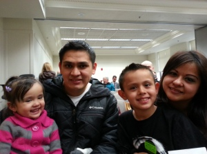 Evelin with her husband and  kids