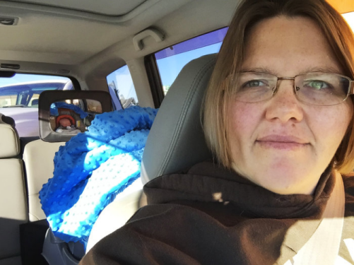 Tricia Olson takes a selfie of herself and her son Augustus, or Gus, who sits in his car seat. Olson took three weeks of unpaid leave from her job at a towing company in Rock Springs, Wyo., after giving birth. Courtesy of Tricia Olson